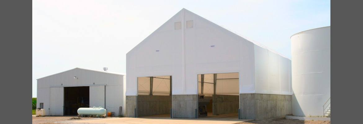 Passive ventilation under the eaves of the fabric building prevents hot spots in stored commodities.