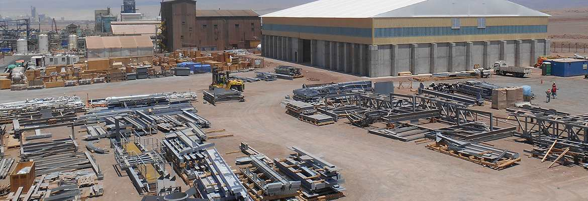 Fabric structures engineered for wide bays accommodate large mining vehicles.