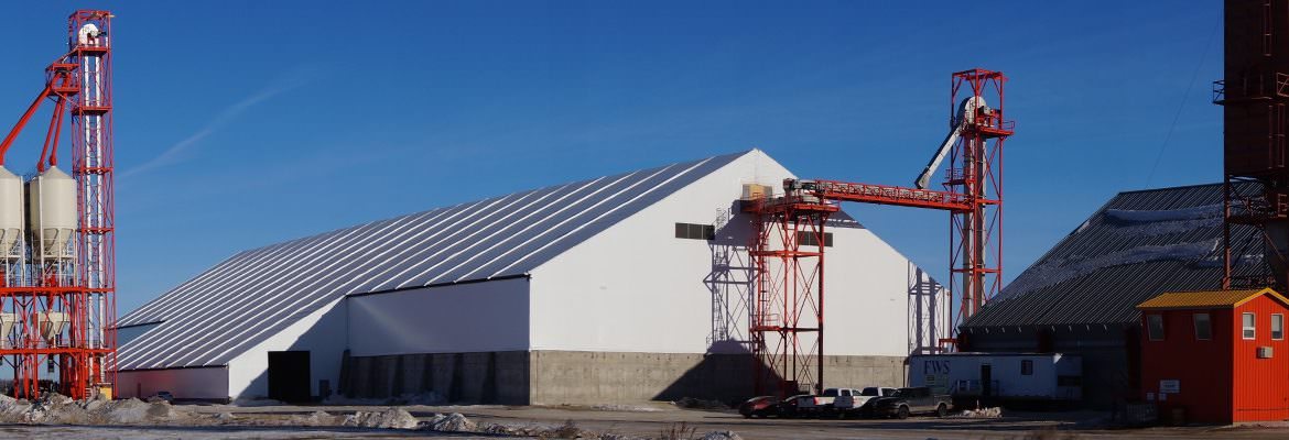 An exterior crane attached to the rigid steel frame fabric commodity storage structure for easy reclamation.